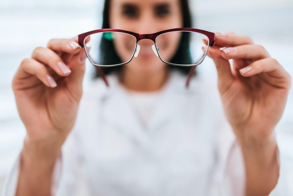 doctor handing eyeglass
