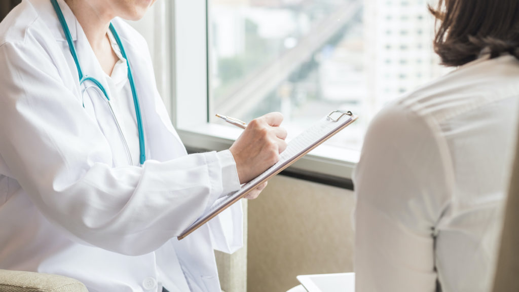 doctor speaking with patient