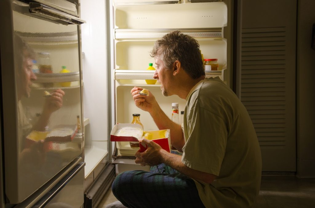 eating in from of the fridge