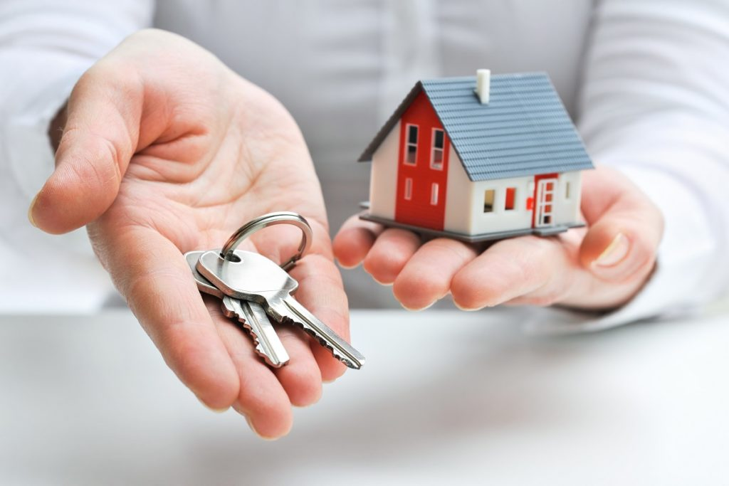 real estate broker holding a house key