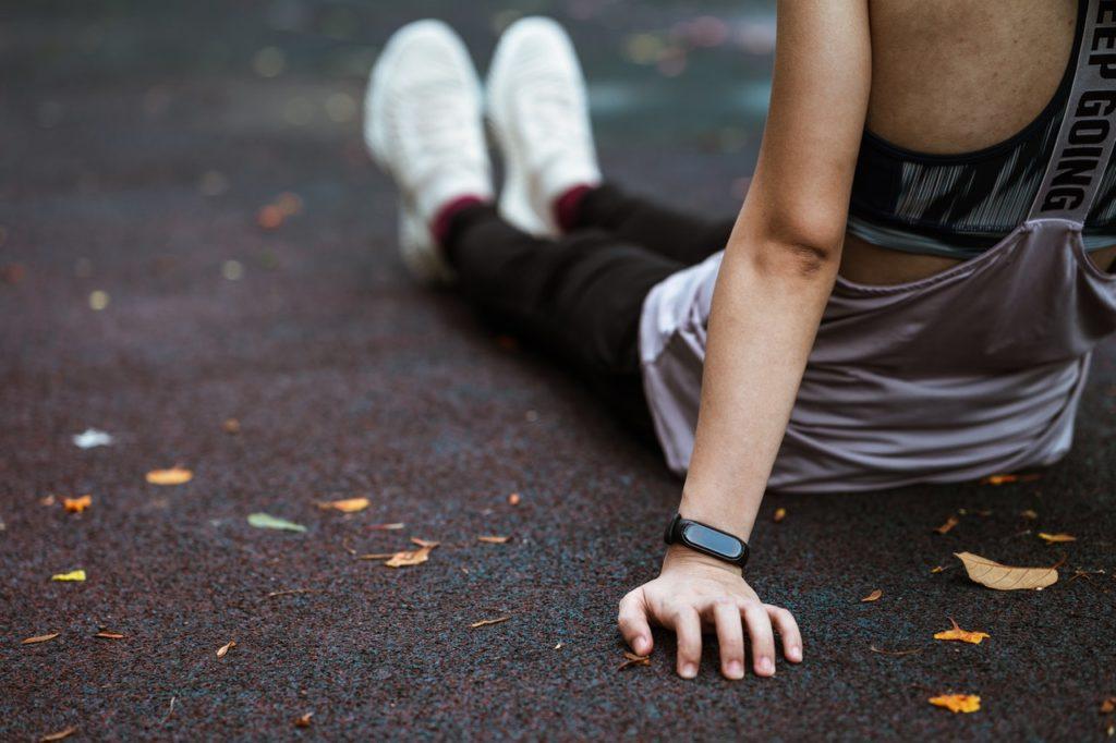 woman wearing smart watch fitness tracker